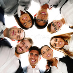 5251783_stock-photo-group-of-business-people-in-a-circle-looking-down